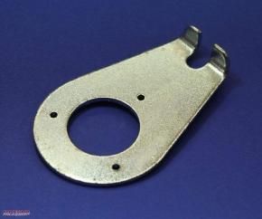 Retaining plate steering damper